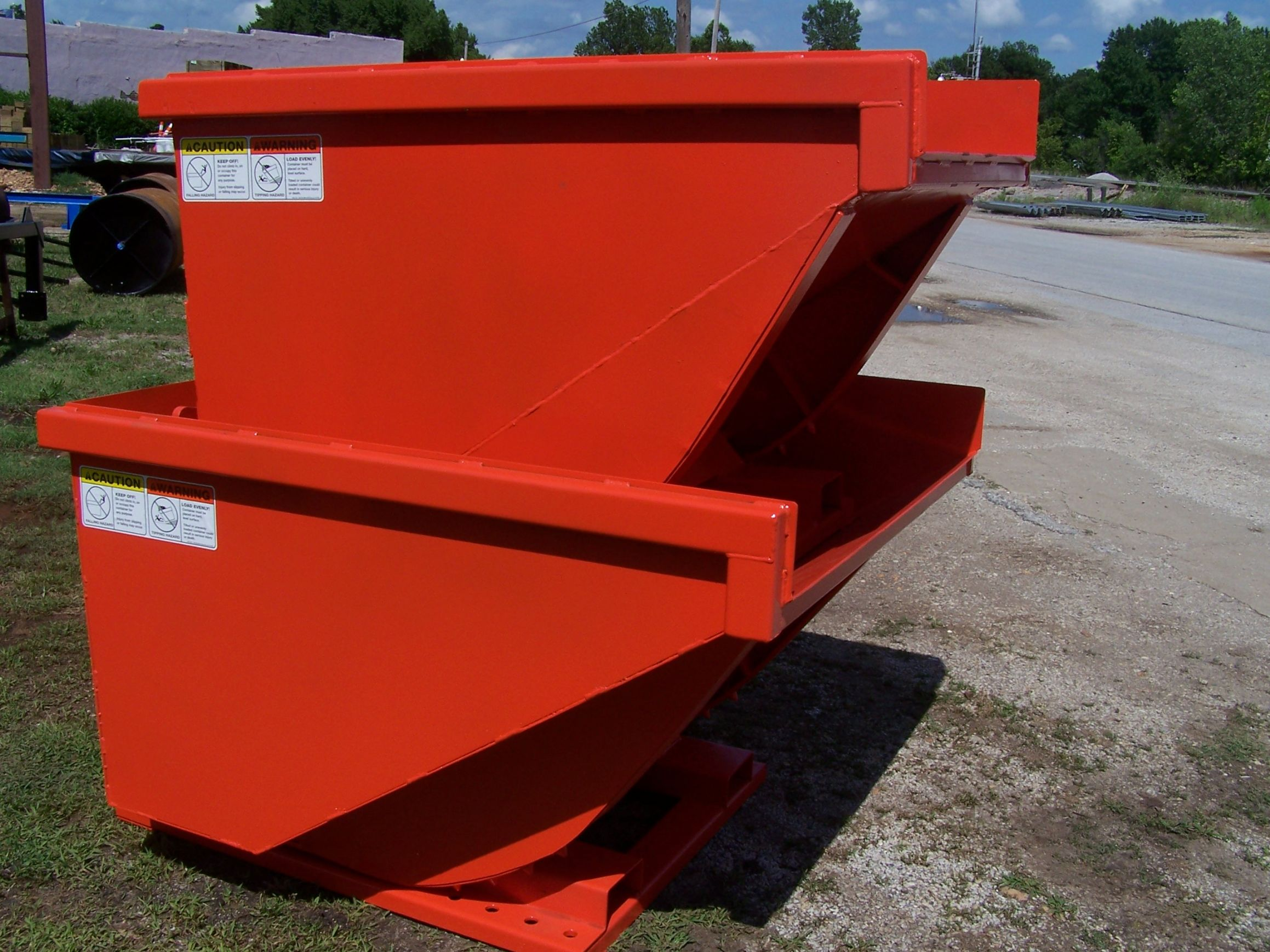 Different sizes of tilt dumpsters